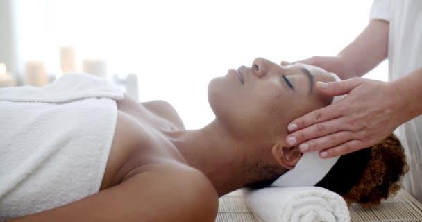Therapist Massaging Female Face Stock Video