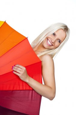 Beautiful young girl with red umbrella, isolated in white, studio shot