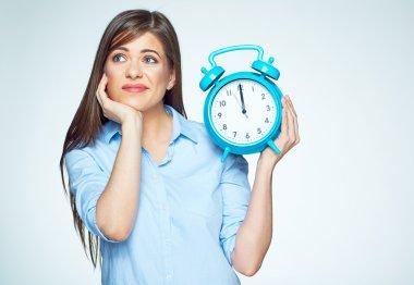 Woman holding alarm watch.