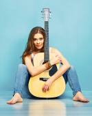 Woman sitting with guitar