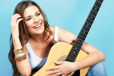 Cute girl with acoustic guitar