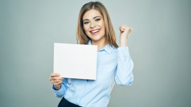 Business woman holds white board