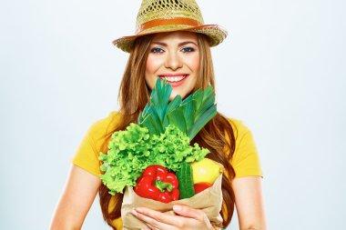 Woman holding vegan food