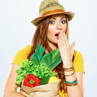 Surprised woman with vegan food