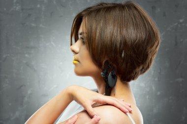 Woman with bob haircut and yellow lips