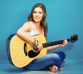 Fotografie Young woman playing guitar