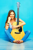 Fotografie Woman sitting with guitar