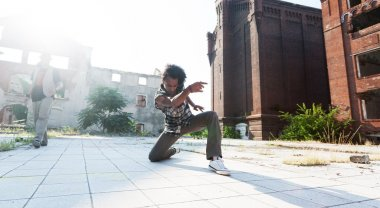 Young man ending off his hip hop dance with a bow