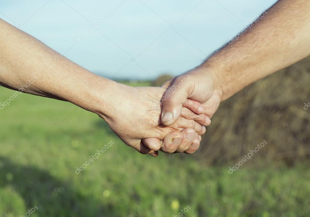 hands of an elderly couple outdoor