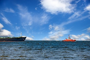Ship with tug