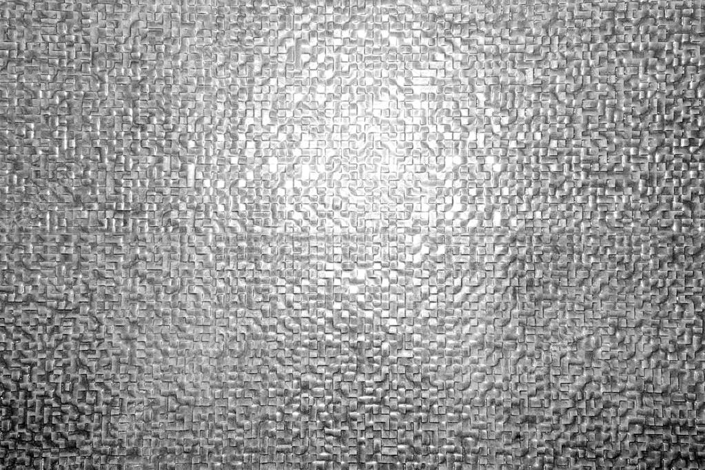 Priorità bassa della parete di piastrelle nere che riflette la luce
