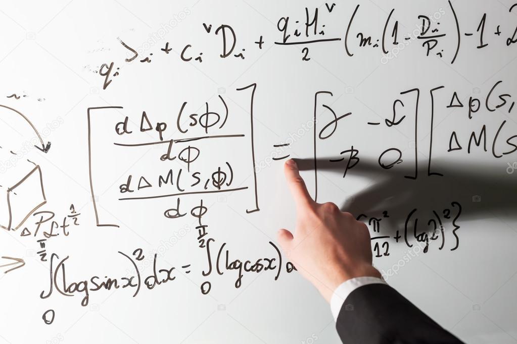 Dedo apontando professor no smbolo da matemtica stock photo dedo apontando professor no smbolo de matemtica igualdade na lousa matemtica e cincia com o conceito de economia reais equaes smbolos escritos ccuart Images