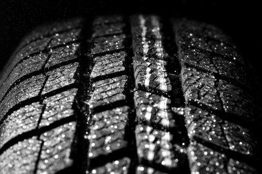 Winter car tire in rain