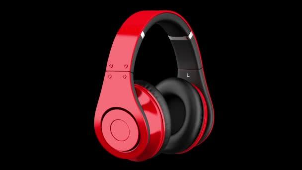 Rote und schwarze drahtlose Kopfhörerschleife drehen sich auf schwarzem Hintergrund