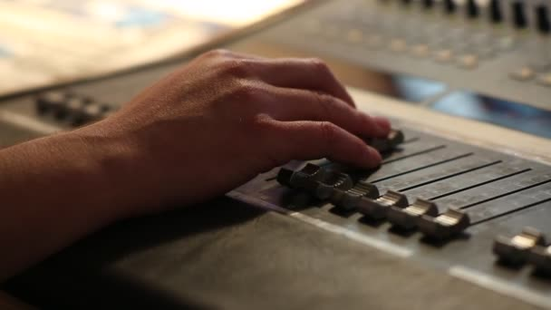 Hand on professional audio mixer