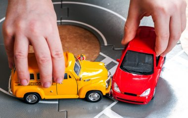 two toy cars accident crash on road
