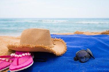 Beach accessories on a sea beach in summer day stock vector