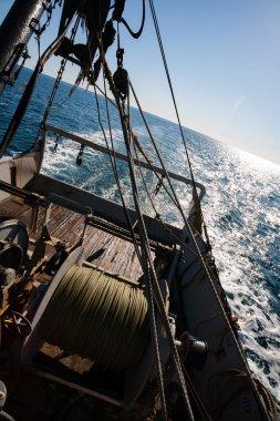 Fishing boat fishing by trawl in coastal waters