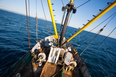 Small fishing seiner goes to fish in coastal waters