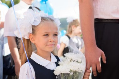 Little girl in the first day of school