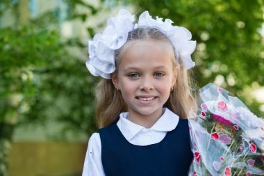 First grader girl with flowers