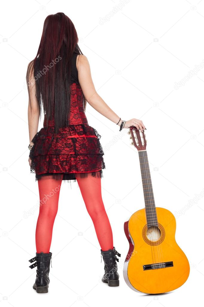 Girl guitarist with guitar rear view