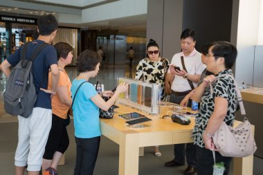 Shoppers in Apple store
