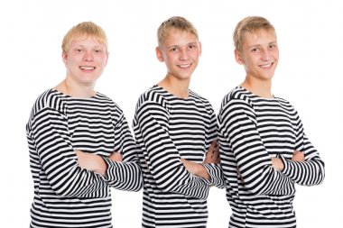 Guys blondes in a striped shirt with arms crossed
