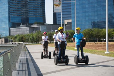 Young people riding on an electric scooter, Singapore