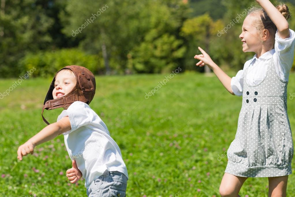 Happy children playing in the paper plane