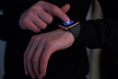 Hands of man with smartwatch