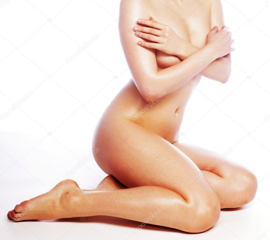 Beautiful naked woman poses covering itself hands