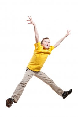 Funny child in yellow t-shirt jumping in excitement with funny expression