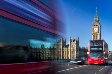 Big Ben and passing red buses, London, United Kingdom