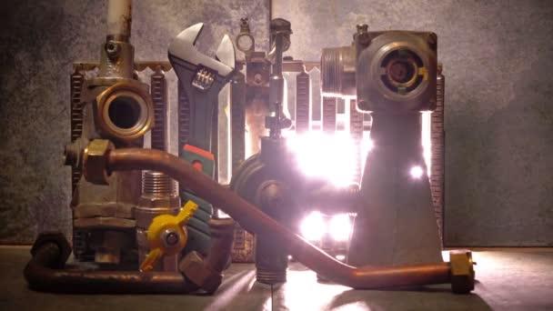 část plynového kotle, vodní armatury a nastavitelný klíč