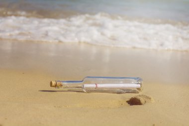 Message in a bottle , at sandy beach stock vector