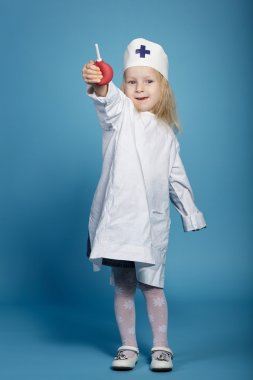 little funny girl playing nurse