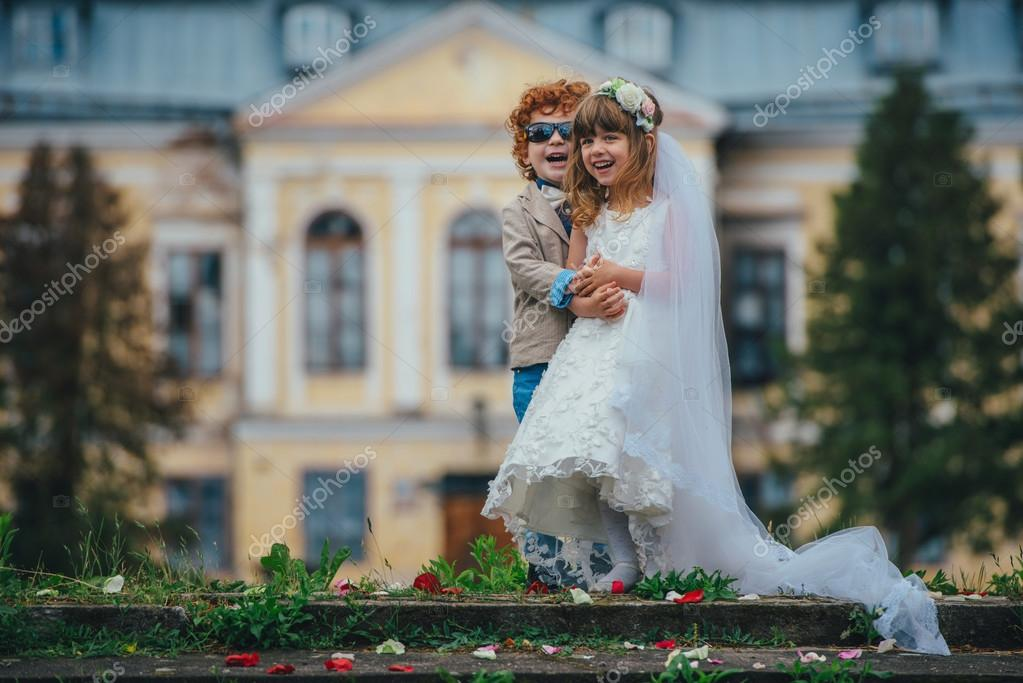 two funny little bride and groom