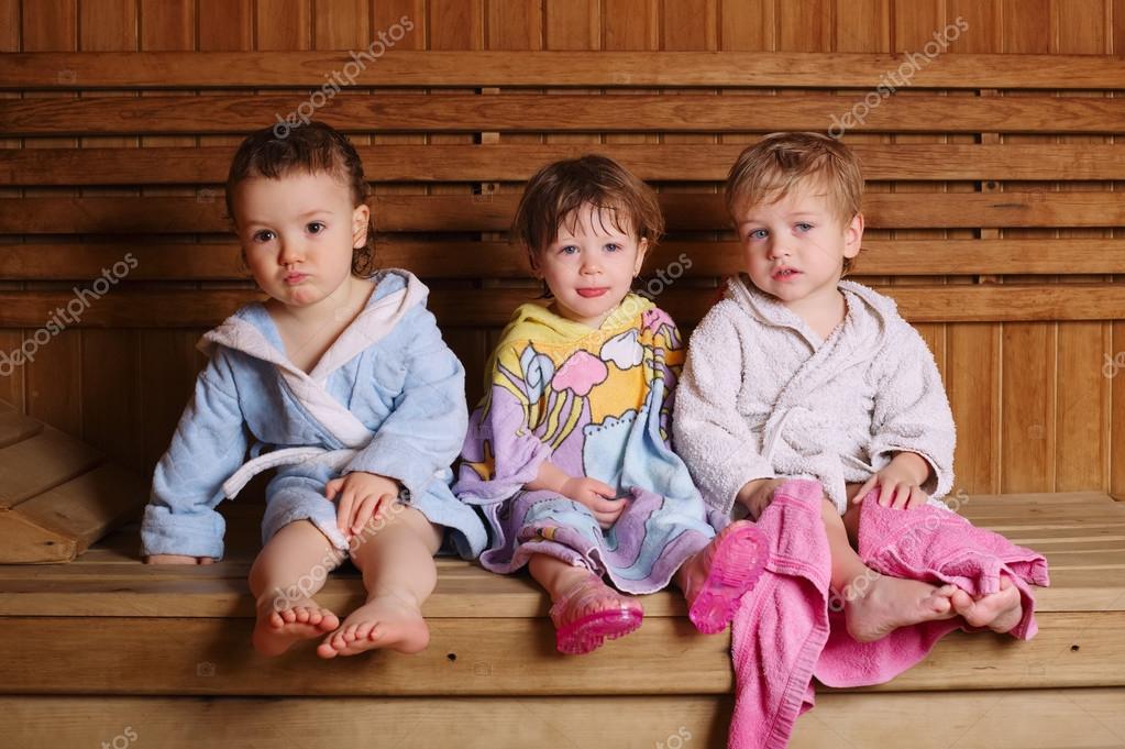 three funny children in sauna