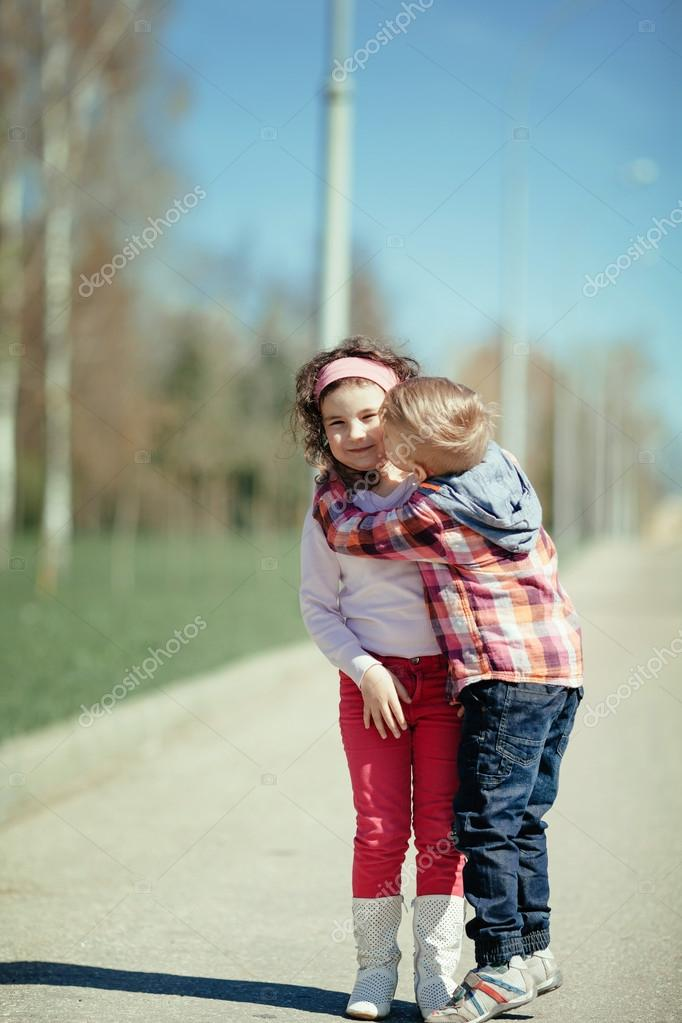 Little Boy Kiss Girl On The Street  Stock Photo  Ababaka -5799