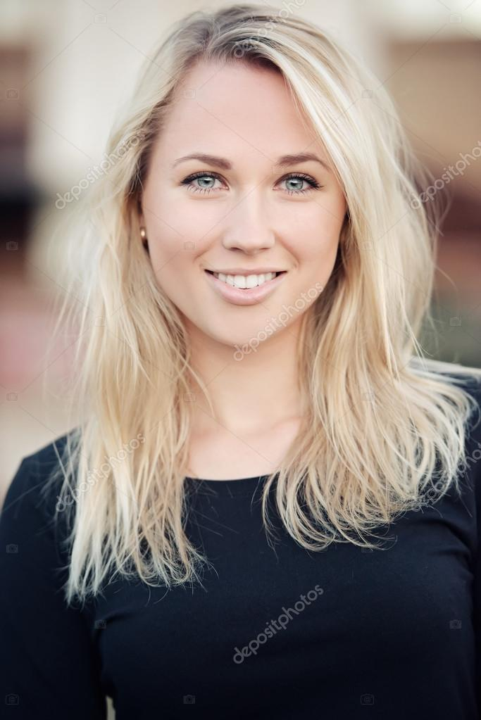 Beautiful blonde girl portrait on the street