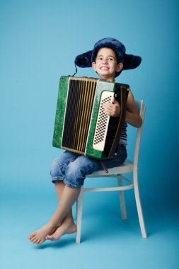 little accordion player on blue background
