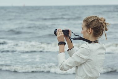 Photo of beautiful youn girl with camera stock vector