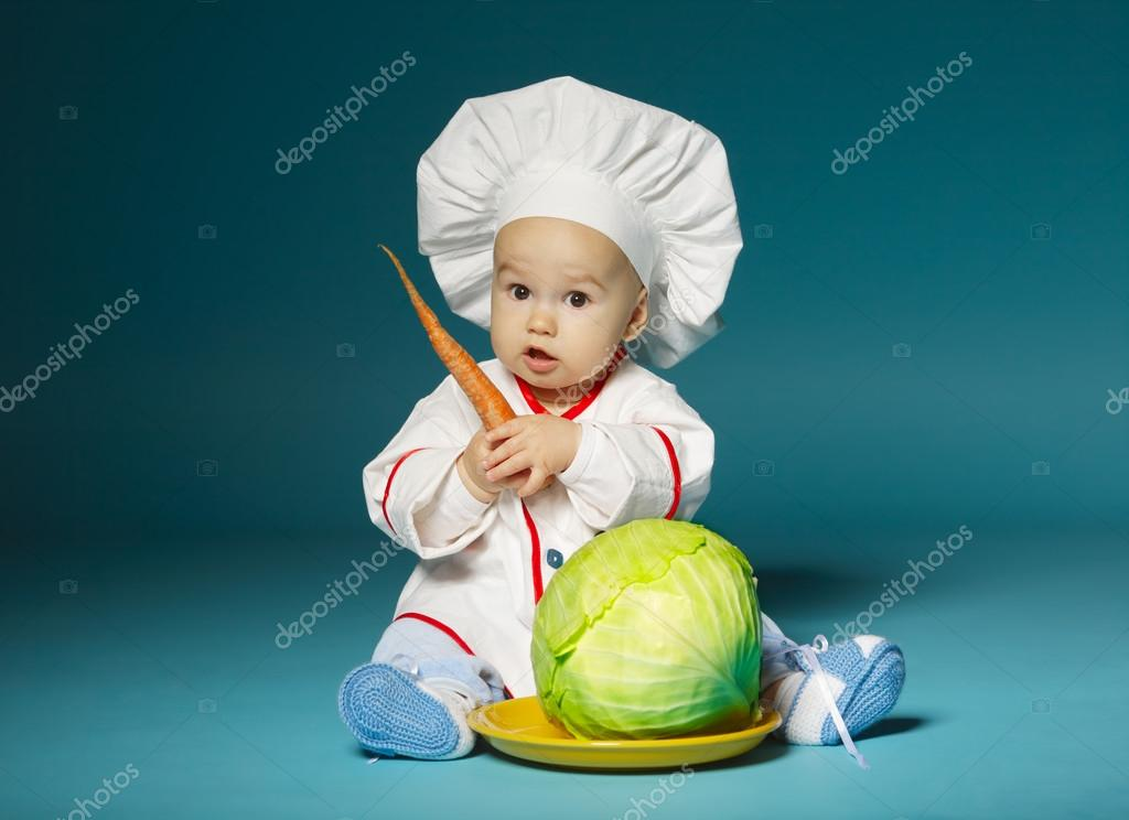 Funny baby with cook costume holds carrot u2014 Stock Photo  sc 1 st  Depositphotos & funny baby with cook costume holds carrot u2014 Stock Photo © ababaka ...