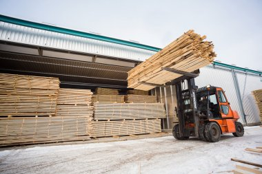 folk lift truck in wood factory