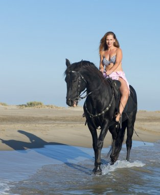 horse woman on the beach