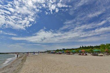 Ukraine, Primorsk 06/20/2020. Azov sea beach in Dorozhnik resort. Bungalows, sun loungers, vacationers and swimmers.