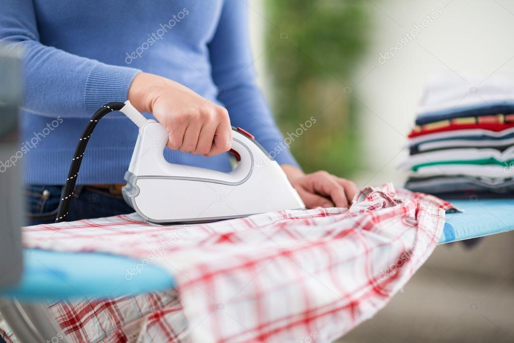 Woman from ironing services iron clothe