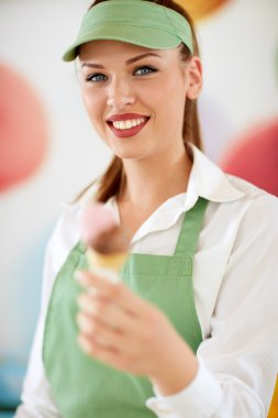 Attractive woman employed in candy store