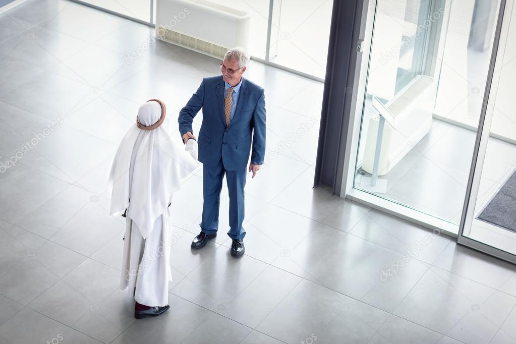 Manager of company receive Arabian partner — Stock Photo